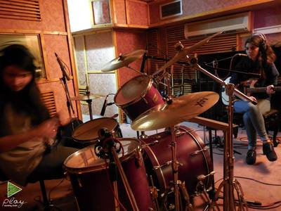 Recording session with a full band drums guitar vocals and bass
