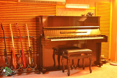 The yamaha piano in Live room 1