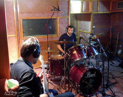 Recording session with a full band